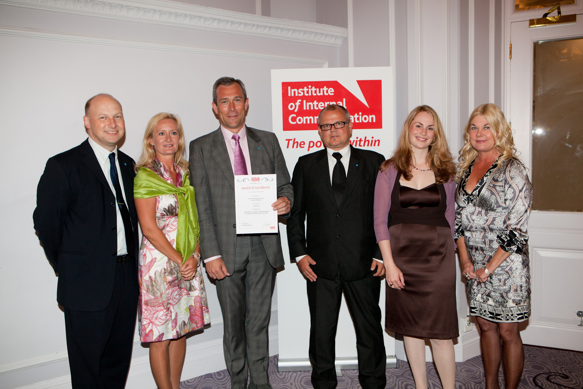 Mark Watkins (left) with the Takeda HR team at the IOIC Awards in 2011.